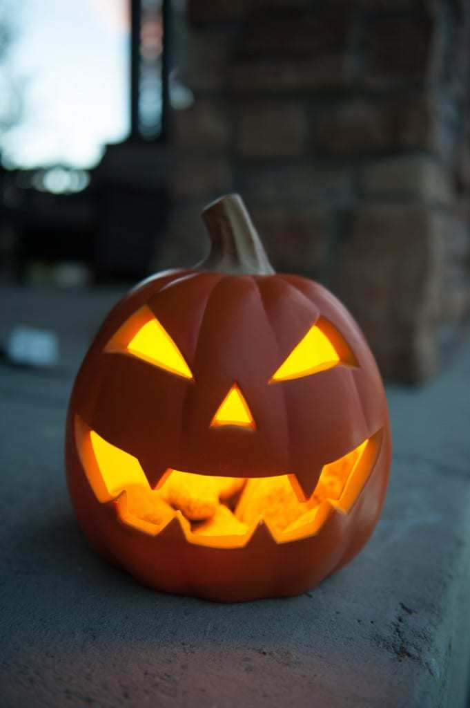 A round jack o'lantern glowing in the dark