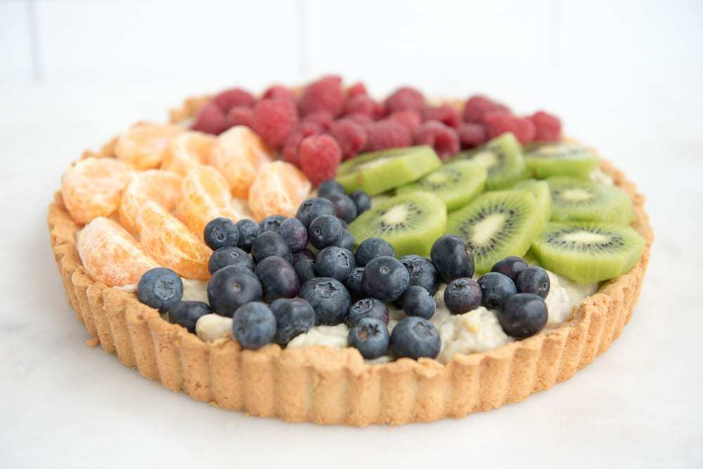 Paleo Fruit Tart with Banana Cream - a paleo and gluten-free dessert recipe perfect for the summer holidays!
