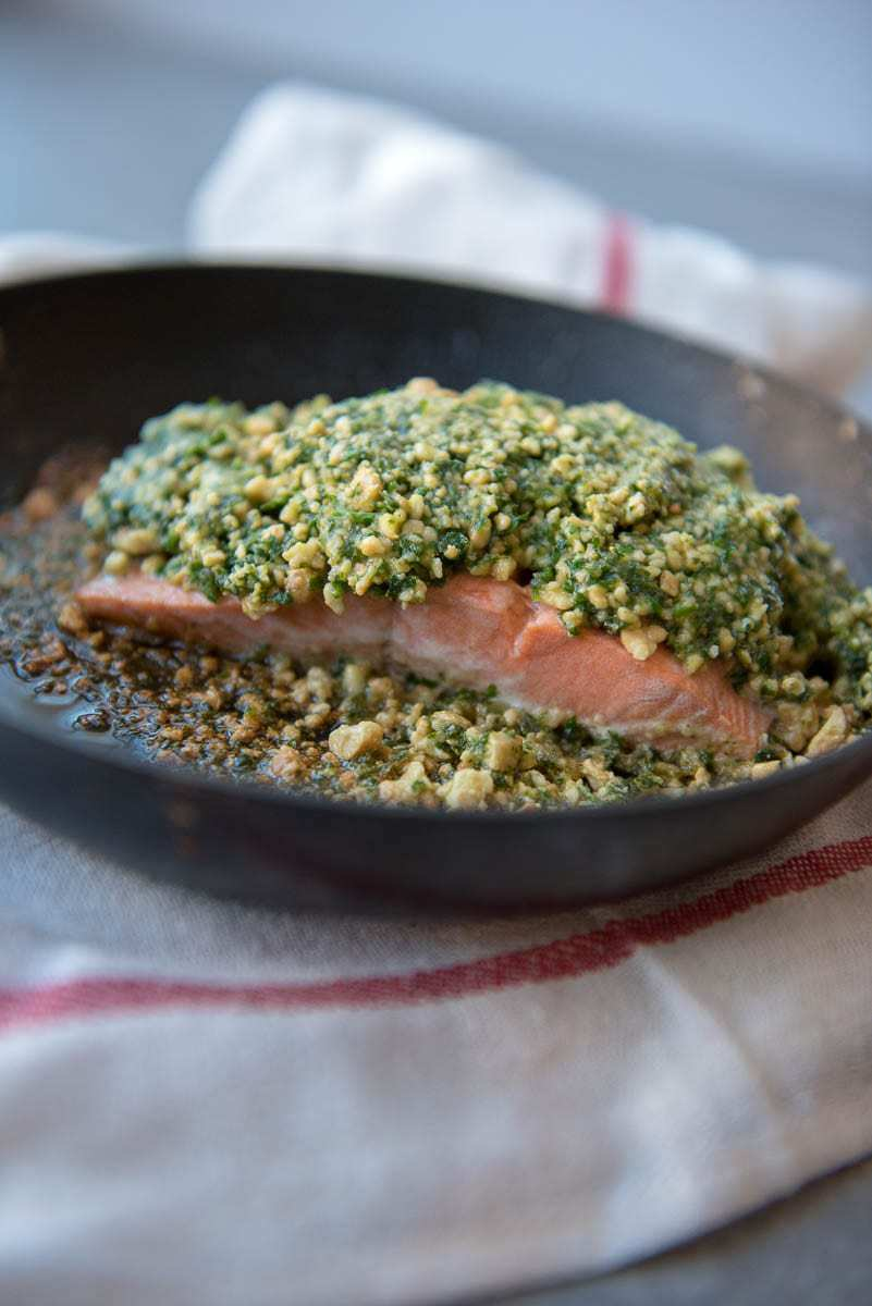 long picture of keto salmon filet in pan with cashew coating