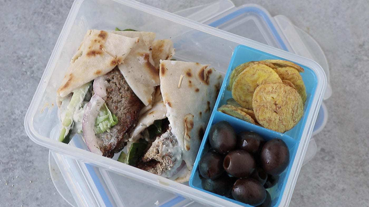 AIP gyro wrap in a lunchbox with a toothpick