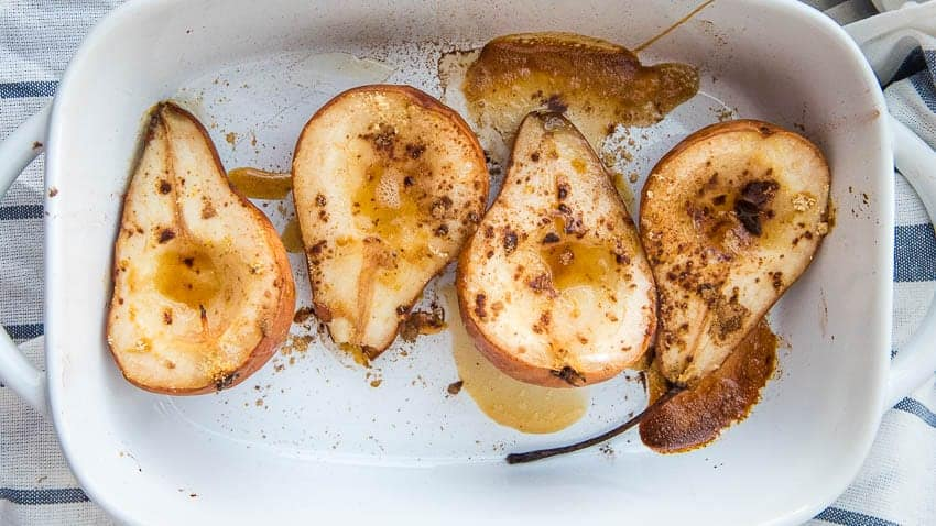 overhead shot of the baked pears in a baking dish