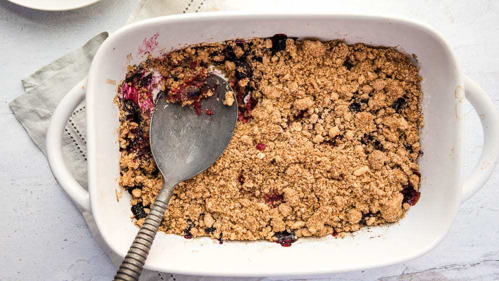 pan filled with berry crumble