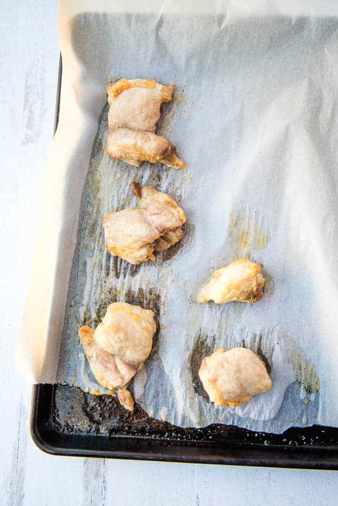 roasted chicken on a baking sheet covered in parchment paper