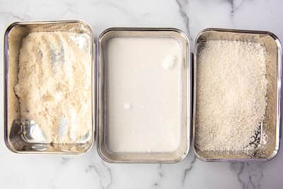 shallow dishes of coconut flour, coconut milk, and shredded coconut