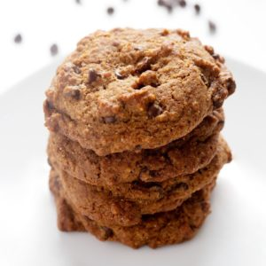 4 AIP Chocolate Chip Cookies stacked on top of each other on a white plate