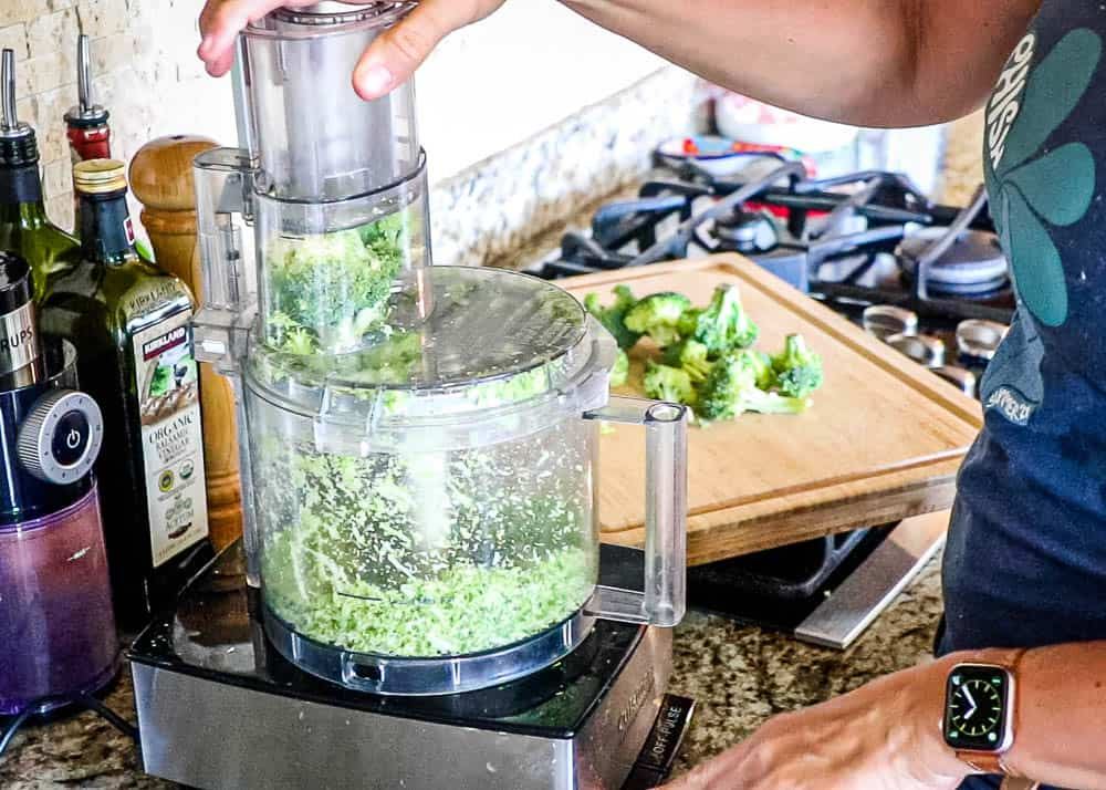 Broccoli being put through a food processor to make rice